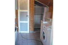 bad-mit-dusche-und-waschmaschine